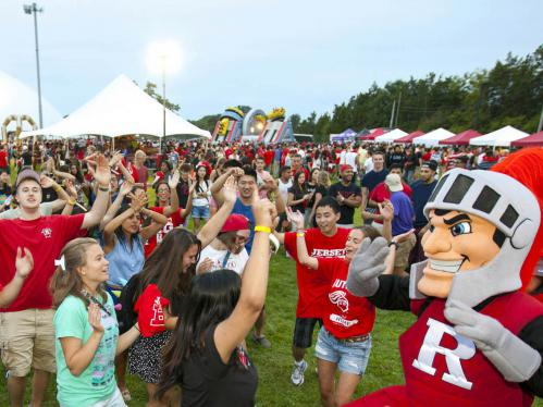 Students dance with Scarlet Knight mascot during new student convocation
